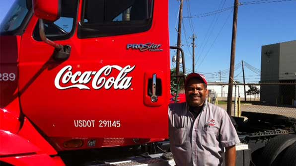 Red Coca-Cola truck and a proud truck driver