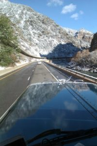 Curved road into the mountains, shot from a truck