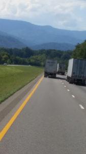 Multiple trucks on the road