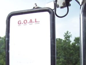"""Get Out And Look"" slogan on rearview mirror"