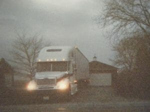 Old photo of a truck with headlights