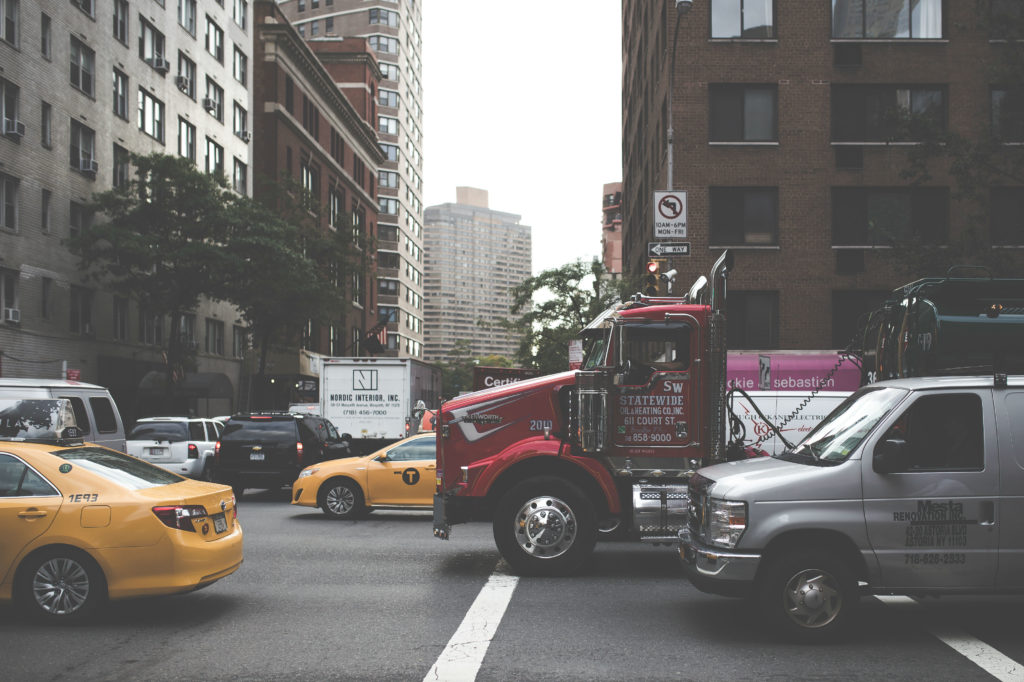 Truck driving through busy city streets