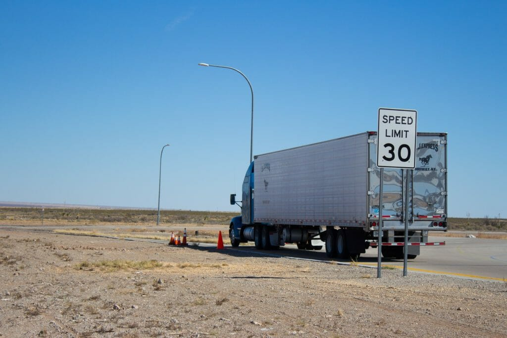 Truck alone in the desert with a slow speed limit
