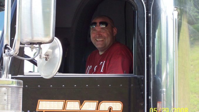 Driver smiling from window of his truck