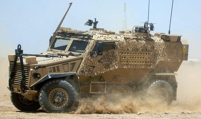 Military truck skidding through the desert