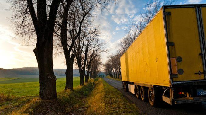 Yellow truck driving into the horizon