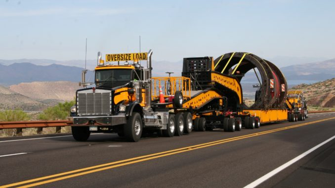 Flatbed truck hauling oversize load