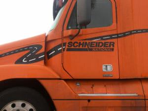 Orange Schneider truck from one of its trucking schools.