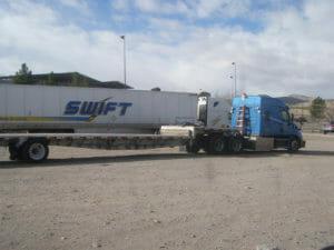 Blue Swift truck in a lot