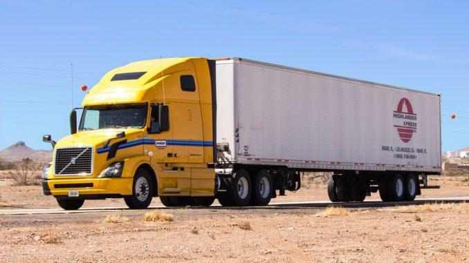 Yellow truck hauling in the desert