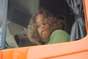 Truck driver through window