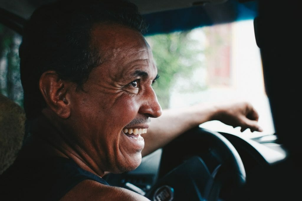 Smiling truck driver behind the wheel