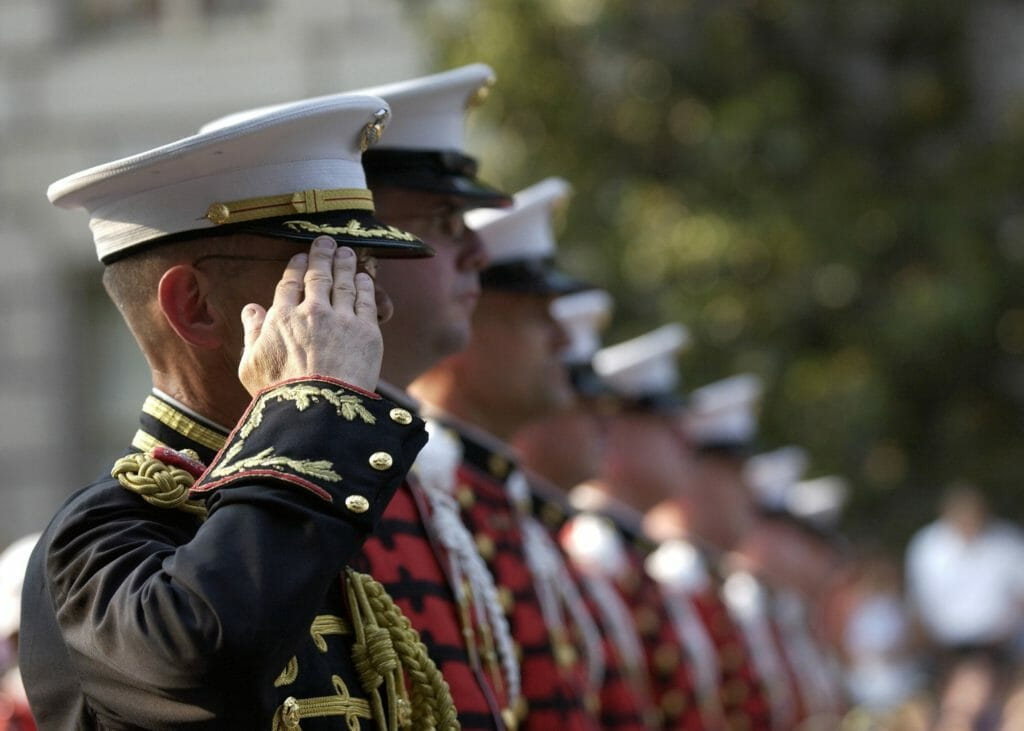 Line of veterans saluting