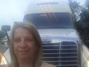 Truck driver selfie in front of truck