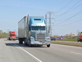 Light blue truck against light blue sky