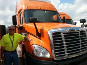 Driver with a big orange truck
