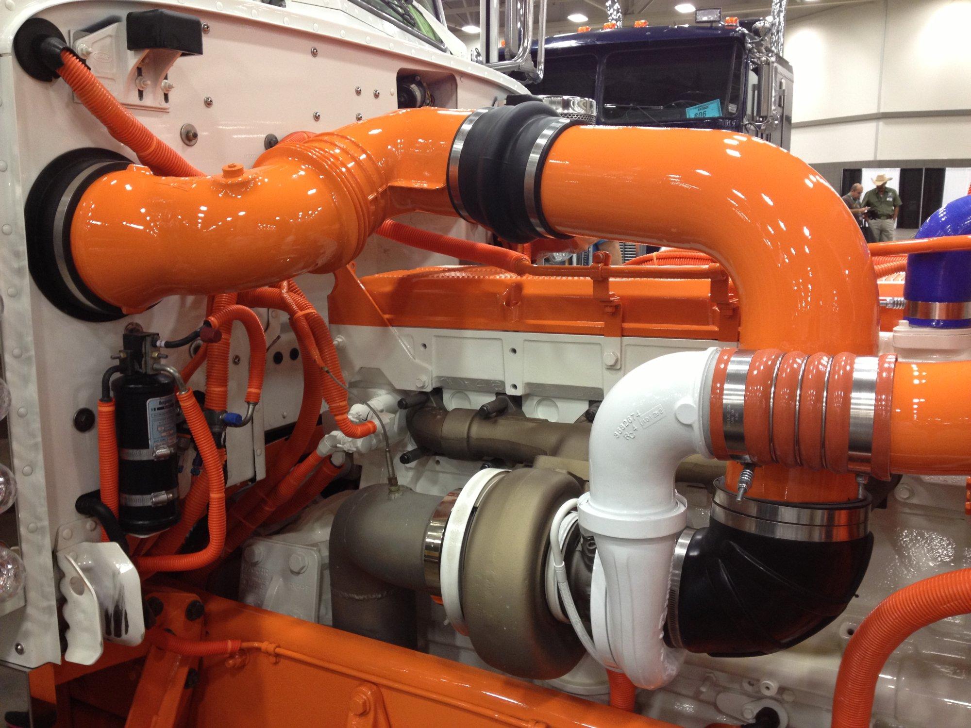 Orange pipes in a diesel engine