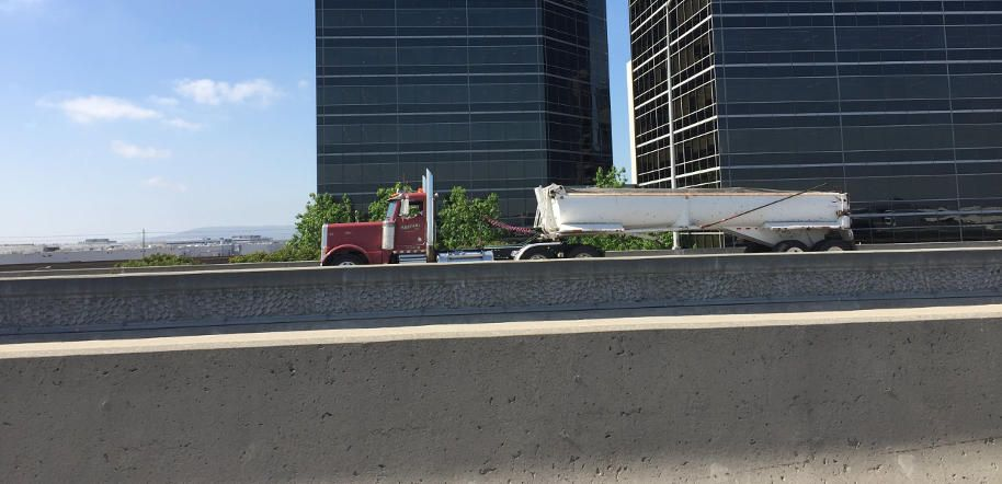 Red truck driving on the highway in Los Angeles