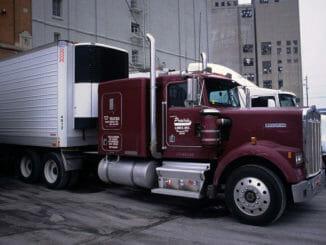 Maroon truck backed up