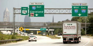 """Cleveland road signs, including a """"No Trucks"""" sign"""