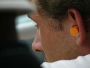 Man with earplugs