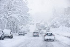 Snowy hazardous driving weather for trucks