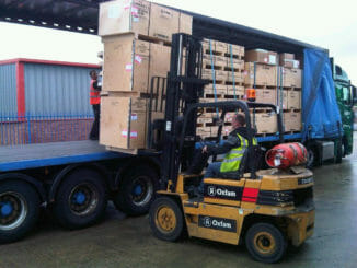 Forklift loading freight into a dry van trailer