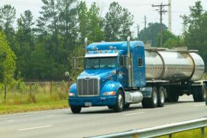 Blue truck hauling liquid freight in a tanker