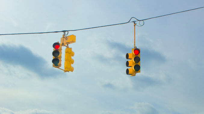 Two hanging red traffic lights