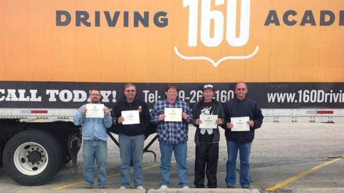 Truck driver students in front of truck with 160 Driving Academy