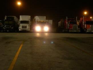 Trucks at a truck stop at night
