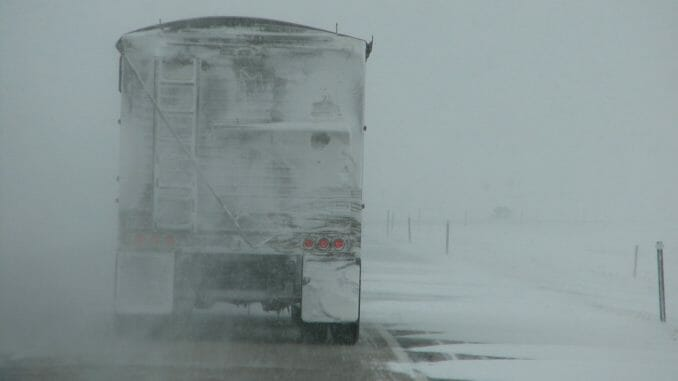 Rear of truck trailer while driving in snowy weather