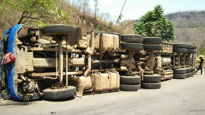 Overturned truck on the side of the road