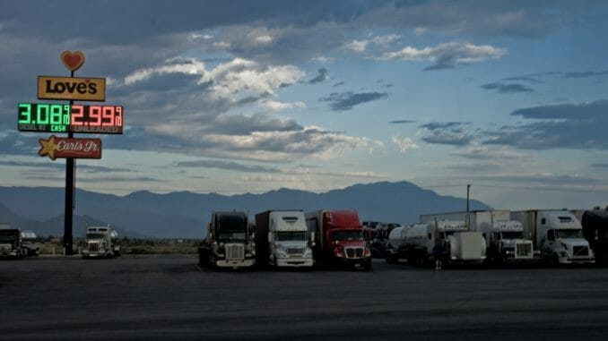 Truck stop with fuel prices in the evening