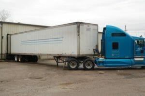 Truck unloading a trailer