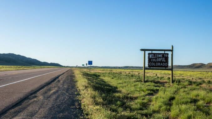 Colorado road with blue sky on horizon