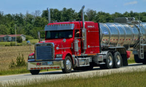 Red truck hauling a tanker