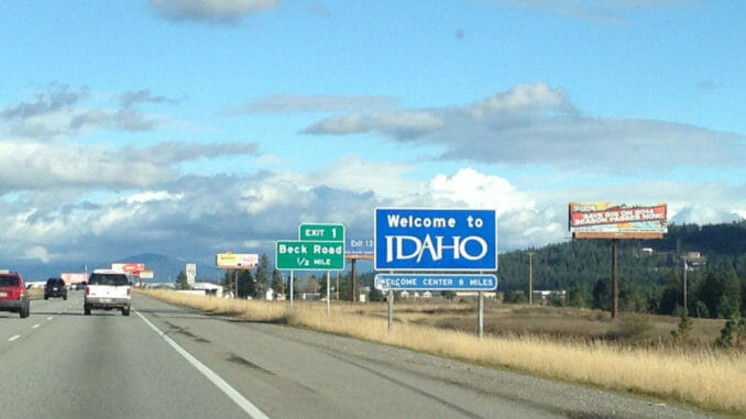 """""""Welcome to Idaho"""" sign on side of road"""