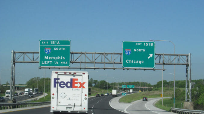 Illinois highway with Fed-Ex truck and signs