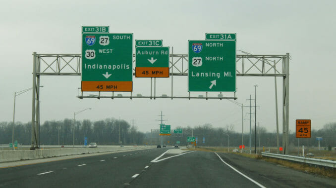 Indiana highway with three signs