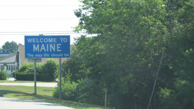 Welcome to Maine sign at side of road