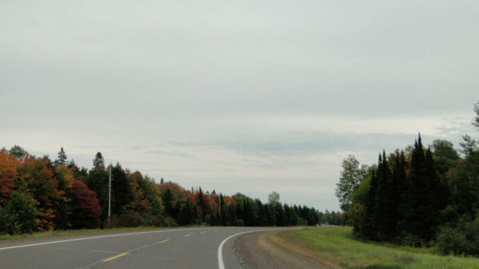 Michigan road under a cloudy sky