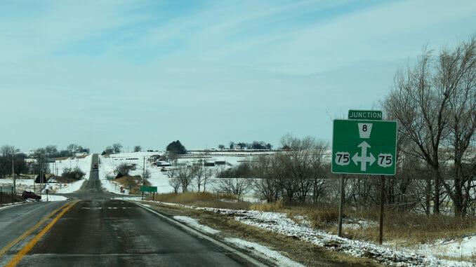 Empty Nebraska road with snow