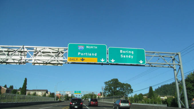 Road signs above an Oregon highway