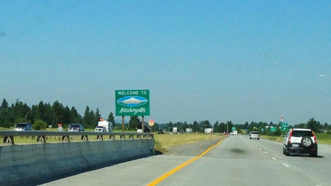 Highway in Washington with trees on horizon