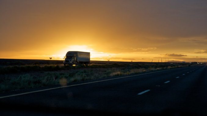 truck driving and backlit by sunset