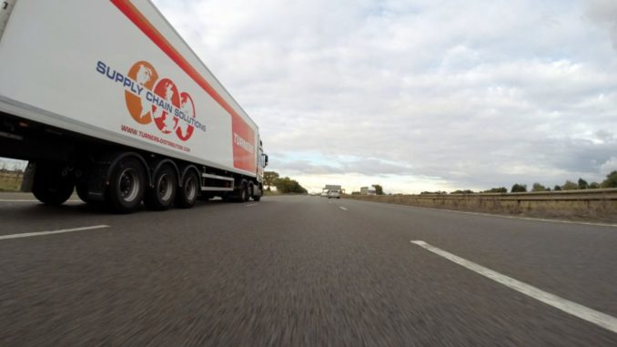 low angle on truck driver towards horizon