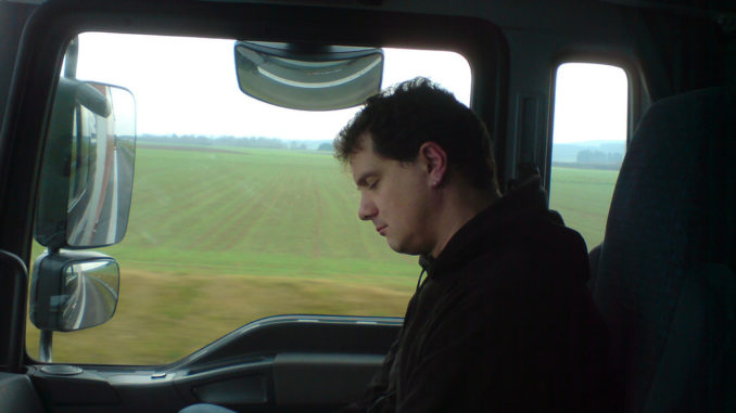 sleeping passenger in a semi-truck