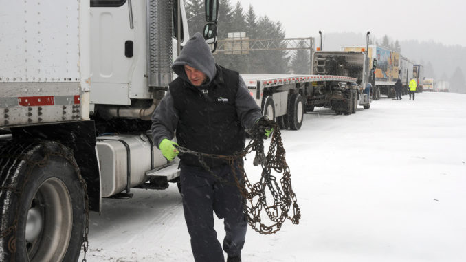 winter tire chains on a truck